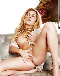 Gorgeous blonde Julia Crown shows off her perfect curves in nothing but lacy lingerie.